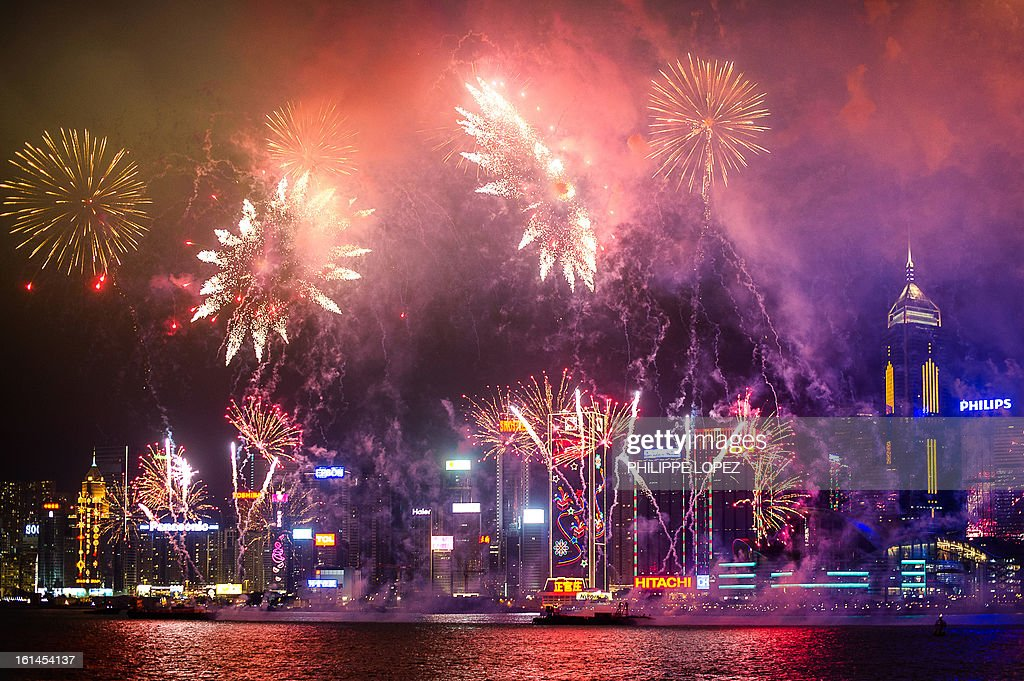 Fireworks illuminate the city's skyline in Hong Kong on February 11, 2013. The Chinese lunar new year, which this year marks the year of the snake, is celebrated by Chinese communities the world over. AFP PHOTO / Philippe Lopez
