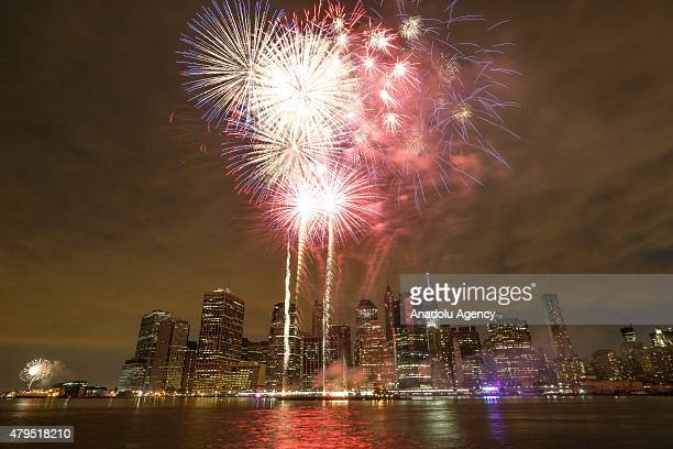 Fireworks illuminate the sky over the East River during the 39th annual Macy's 4th of July fireworks in New York City on July 04 2015