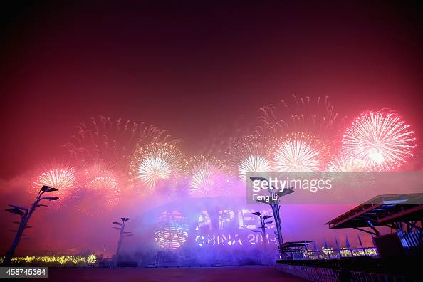 Fireworks illuminate the sky over the National Stadium known as 'Bird's Nest' during the Welcome Banquet for 2014 APEC leaders at the National...