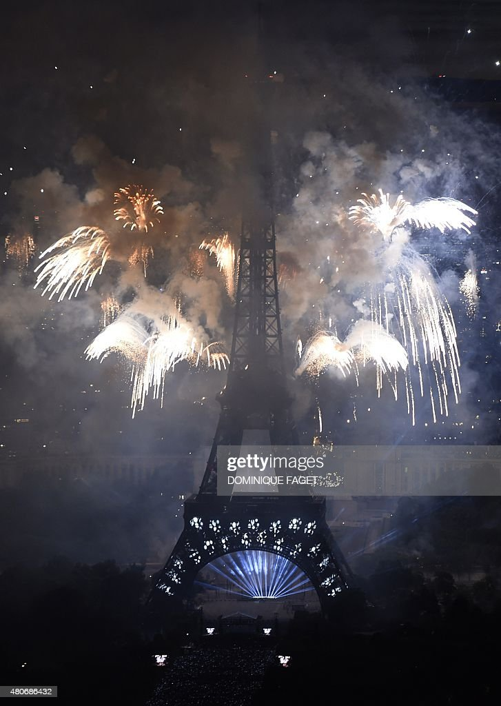 Fireworks light skies above the Eiffel Tower in the French capital Paris on July 14 2015 as part of France's annual Bastille Day celebrationsAFP...