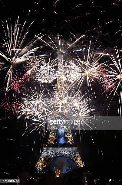 Fireworks light the skies above the Eiffel Tower in the French capital Paris on July 14 2015 as part of France's annual Bastille Day celebrations AFP...