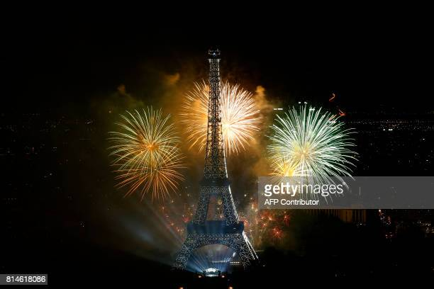 Fireworks light the sky above the Eiffel Tower in the French capital Paris on July 14 2017 as part of France's annual Bastille Day celebrations as...