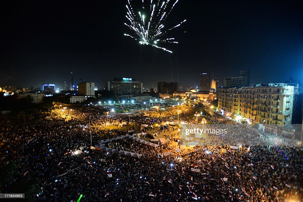 Fireworks light the sky as thousands of Egyptians gather to demonstrate against President Mohamed Morsi and the Muslim Brotherhood in Cairo's...