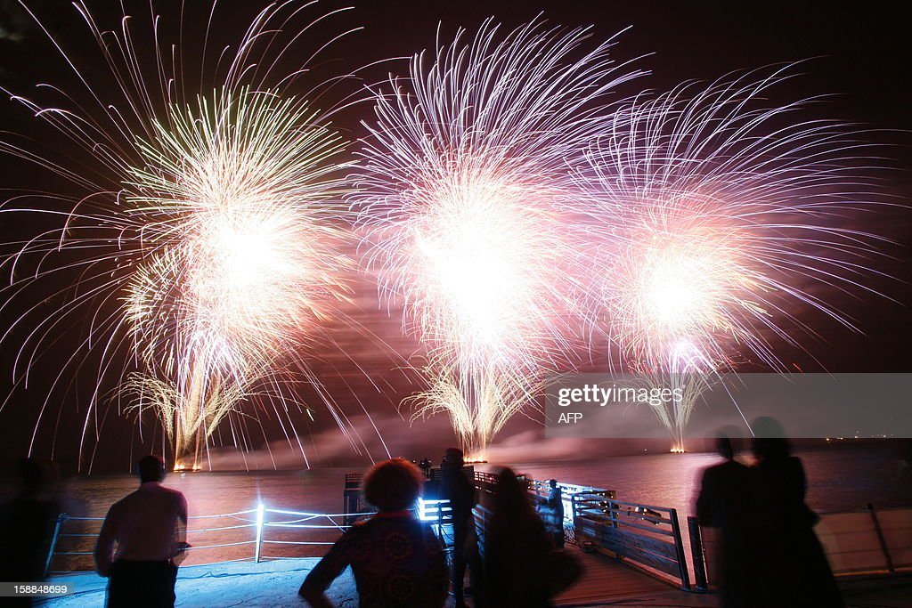 Fireworks light the sky in Dakar during the New Year celebrations on January 1, 2013. AFP PHOTO / Mamadou Toure BEHAN