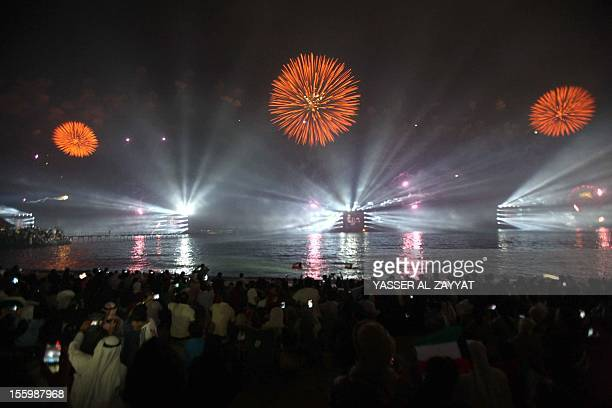 Fireworks light the sky near the Kuwait Towers during celebrations marking the Gulf state's 50th anniversary of its constitution in Kuwait City on...