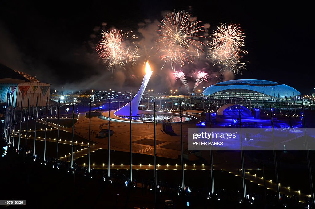 Fireworks light the sky over the Fisht Olympic Stadium as the Olympic flame is lit at the end of the Opening Ceremony of the 2014 Sochi Winter...