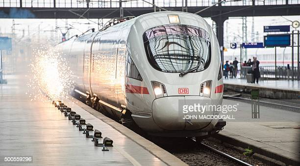 Fireworks light up along the platform as the inaugural InterCity Express train linking Erfurt to Halle/Leipzig pulls into Leipzig's main railway...