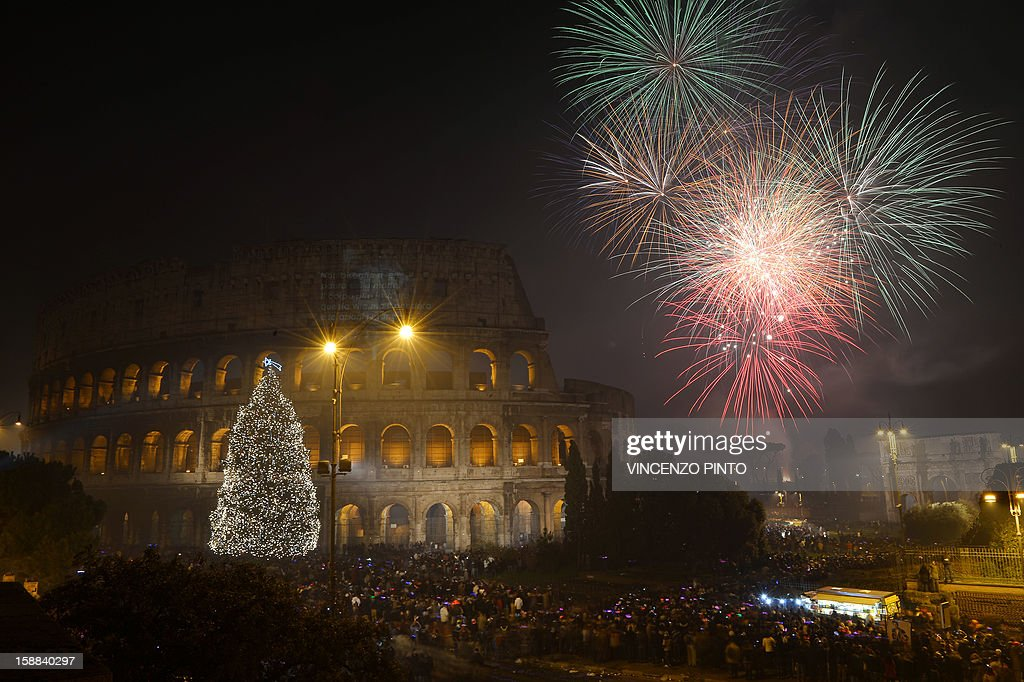 Fireworks light up the ancient Colisseum in central Rome's via dei Fori just after midnight on January 1, 2013. World cities from Sydney to Dubai rang in the New Year with a spectacular global wave of firework displays.