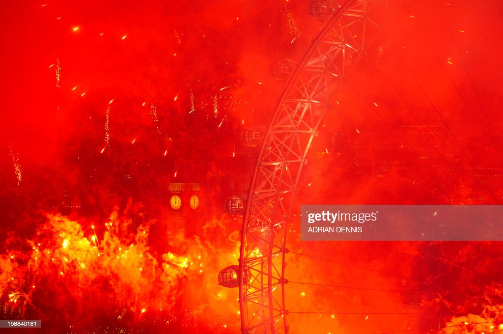 Fireworks light up the Big Ben and the London Eye in central London just after midnight on January 1, 2013. AFP PHOTO/ADRIAN DENNIS
