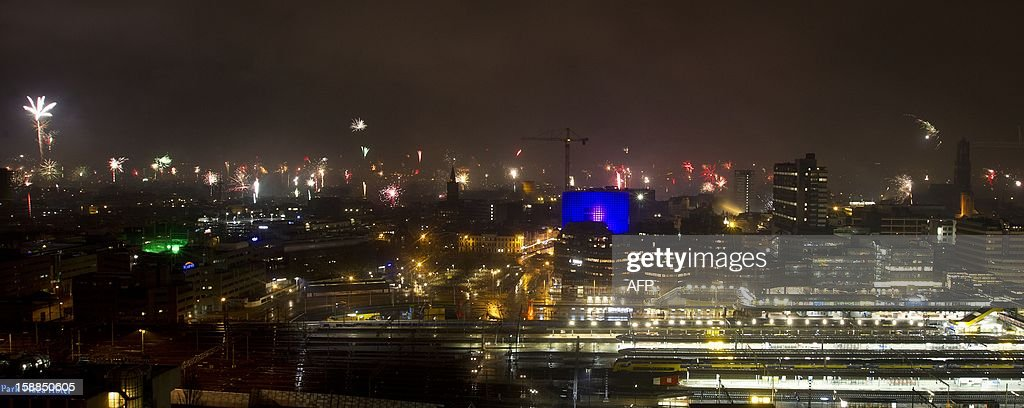 Fireworks light up the Central Station during New Year's celebrations in Utrecht, on January 1, 2013. AFP PHOTO / ANP EVERT-JAN DANIELS Netherlands out