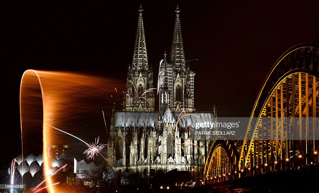 Fireworks light up the Dom church on the Rhine river in Cologne , western Germany just after midnight on January 1, 2013 as part of the New Year's celebrations.