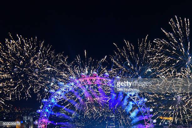 Fireworks light up the London Eye just after midnight on January 01 2016 in London England Thousands of people lined the banks of the River Thames in...