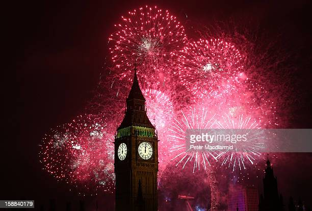 Fireworks light up the London skyline and Big Ben just after midnight on January 1 2013 in London England Thousands of people are lining the banks of...
