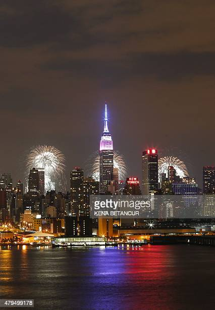 Fireworks light up the New York City skyline during 39th annual Macy's 4th of July fireworks for Independence day as seen from Weehawken New Jersey...