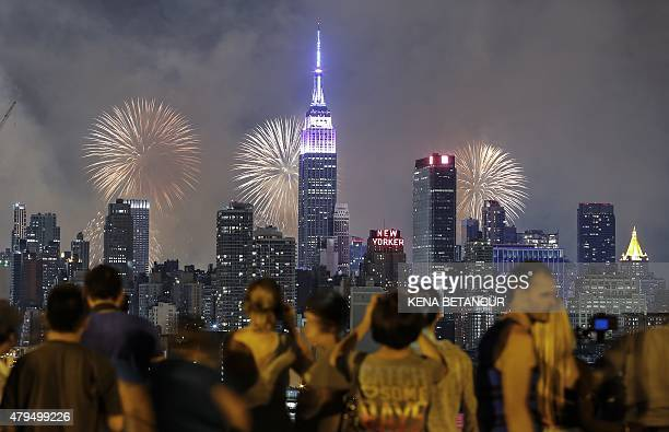 Fireworks light up the New York City skyline during 39th annual Macy's 4th of July fireworks on Independence day as seen from Weehawken New Jersey on...