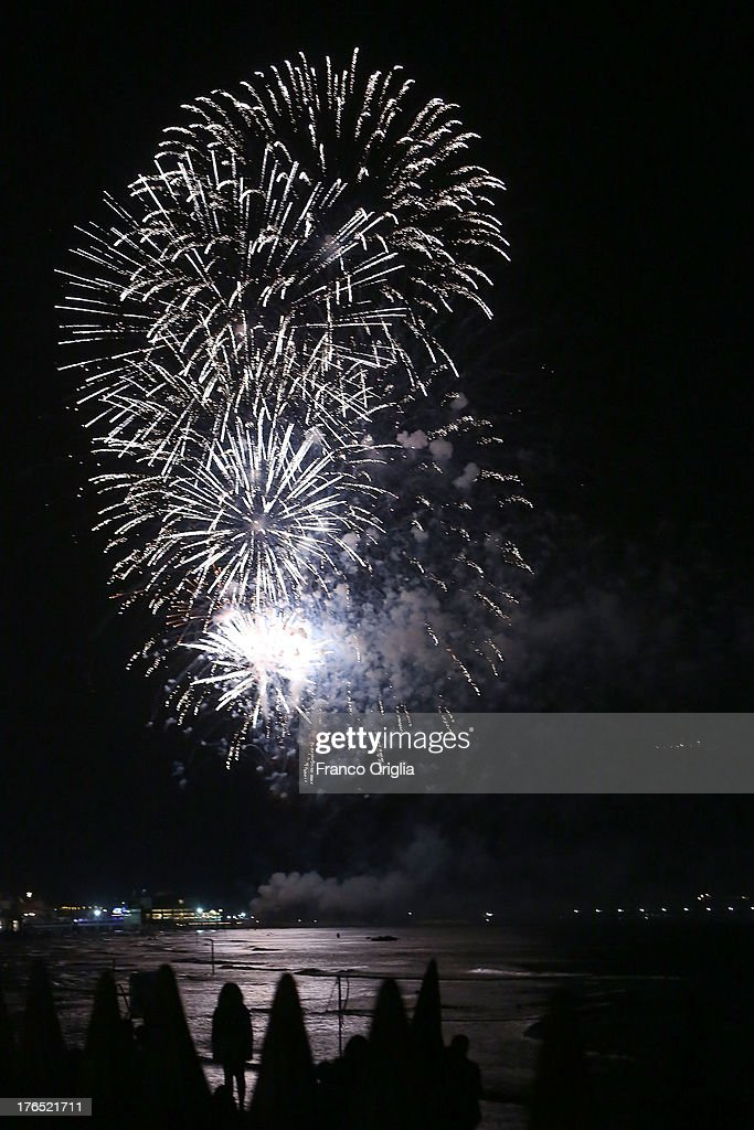 Fireworks light up the sky above the beach of Follonica and Punta Ala celebrating the 'Ferragosto' on August 15, 2013 in Grosseto, Italy. The term Ferragosto is derived from the Latin expression Feriae Augusti (Augustus' rest), which is a celebration introduced by the emperor Augustus.