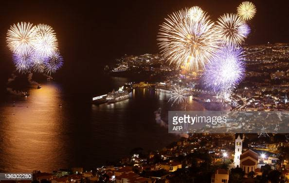 Fireworks light up the sky above the Funchal bay in Funchal Madeira Island on January 1 celebrating the arrival of the new year AFP PHOTO/ GREGORIO...