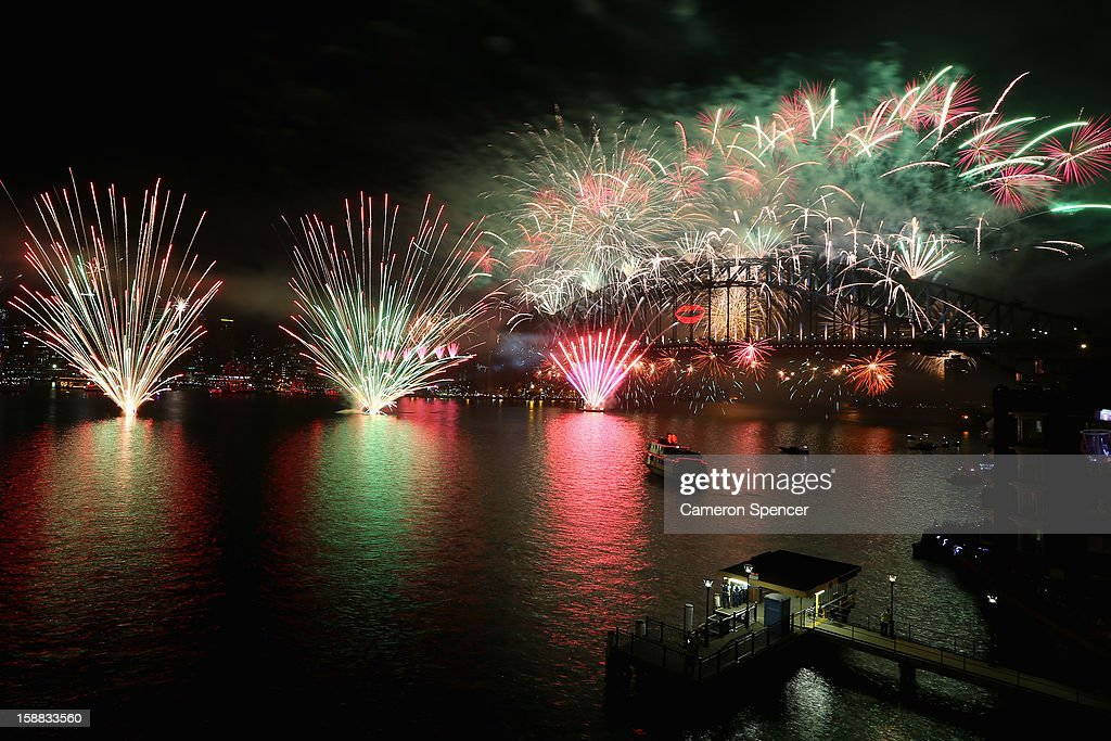 Fireworks light up the sky above the Sydney Harbour Bridge at midnight during New Years Eve celebrations on Sydney Harbour on December 31, 2012 in Sydney, Australia.