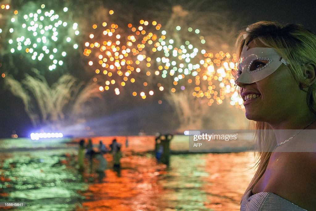 Fireworks light up the sky along Copacabana Beach in Rio de Janeiro on January 1, 2013, during celebrations by over three million people attending New Year's Eve festivities. World cities from Sydney and Hong Kong to Dubai and London rang in the New Year with spectacular fireworks, as revelers at Times Square in New York sought to top off the global extravaganza. AFP PHOTO / ARI VERSIANI