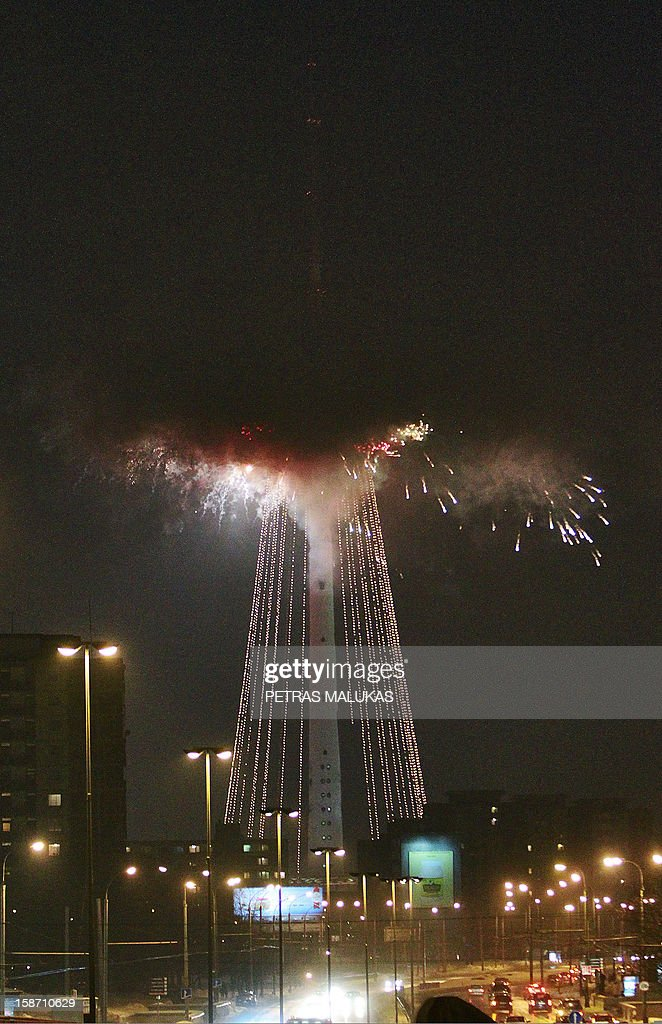 Fireworks light up the sky around a 326-meter high Christmas tree shaped installation at the TV tower, during a lighting up ceremony in Vilnius, Lithuania, December 25, 2012.