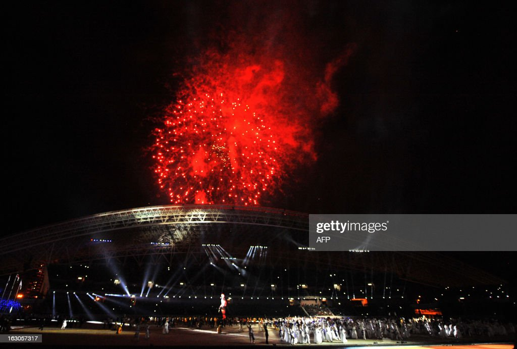 Fireworks light up the sky as artists perform during the opening ceremony for the 2013 Central American Games in San Jose on March 3, 2013. The 10th Central American Games are taking place from March 3 to 17 in Costa Rica. AFP PHOTO / Ezequiel BECERRA