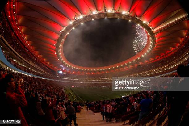 Fireworks light up the sky during the inauguration of the Wanda Metropolitano stadium after the Spanish league football match Club Atletico de Madrid...