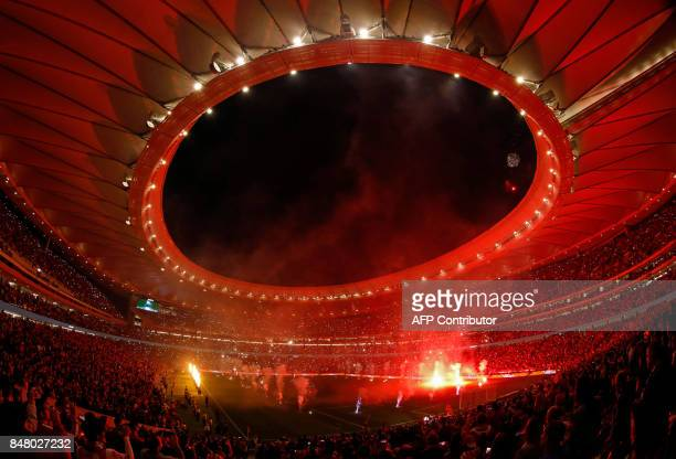 TOPSHOT Fireworks light up the sky during the inauguration of the Wanda Metropolitano stadium after the Spanish league football match Club Atletico...