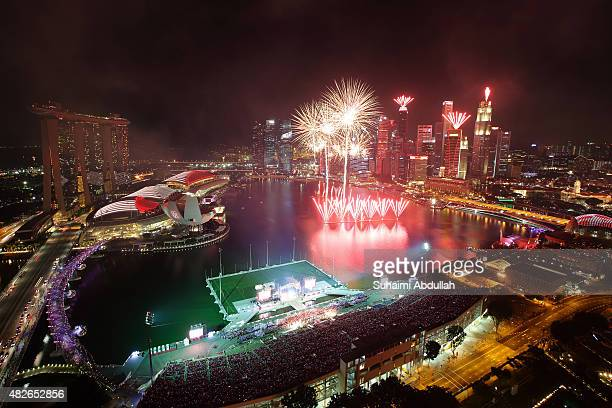 Fireworks light up the sky during the National Day Parade preview at the Marina Bay on August 1 2015 in Singapore Singapore will be celebrating her...