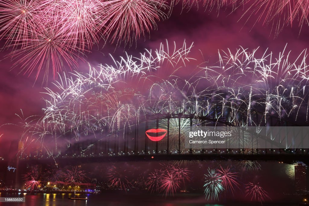 Fireworks light up the sky from The Sydney Harbour Bridge at midnight during New Years Eve celebrations on Sydney Harbour on December 31, 2012 in Sydney, Australia.
