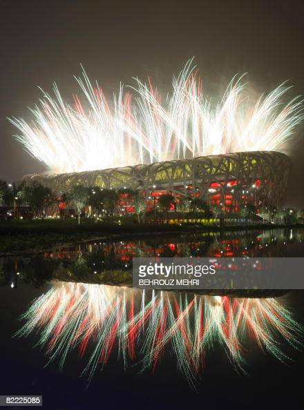 Fireworks light up the sky in front of the National Stadium known as the 'Bird's Nest' during the opening ceremony of the 2008 Beijing Olympic Games...