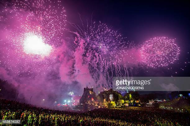 Fireworks light up the sky on the third day of the second weekend of the Tomorrowland music festival in Boom Belgium on July 27 2014 The 10th edition...