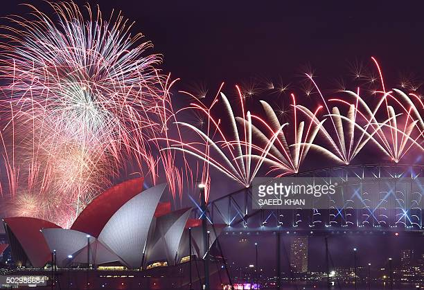 Fireworks light up the sky over Sydney's Opera House and Harbour Bridge during New Year celebrations in Sydney on January 1 2016 AFP PHOTO / Saeed...
