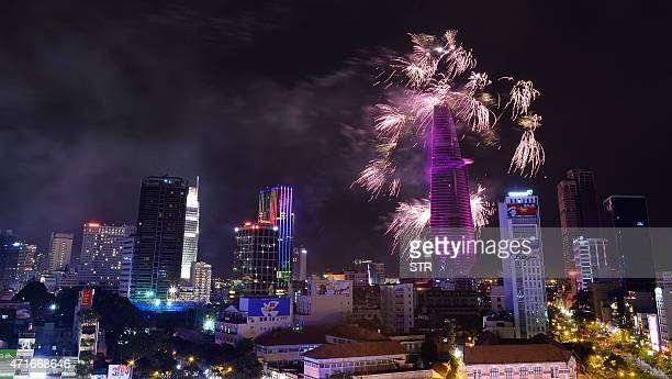 Fireworks light up the sky over the centre of Ho Chi Minh City late on April 30 2015 as part of celebrations marking the 40th anniversary of the fall...