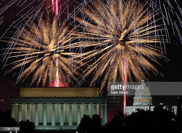 Fireworks light up the sky over the Lincoln Memorial Washington Monument and the US Capitol on July 4 2013 in Washington DC July 4th is a national...