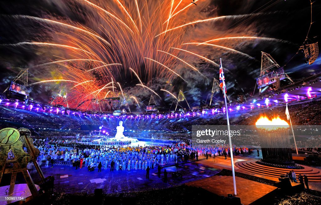 Fireworks light up the stadium as a large scale reproduction of Marc Quinn's celebrated sculpture 'Alison Lapper Pregnant' emerges during the Opening Ceremony of the London 2012 Paralympics at the Olympic Stadium on August 29, 2012 in London, England.