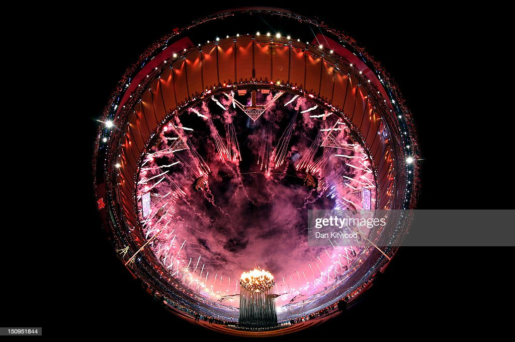 Fireworks light up the stadium as the Paralympic Caudron burns during the Opening Ceremony of the London 2012 Paralympics at the Olympic Stadium on August 29, 2012 in London, England.