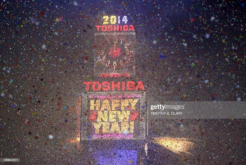 Fireworks light up Times Square as the Countdown Ball drops as thousands of revelers gather in New York's Times Square to celebrate the ball drop at...