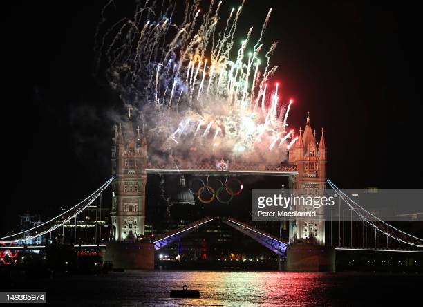 Fireworks light up Tower Bridge as the London 2012 Olympics opening ceremony takes place on July 27 2012 in London England Athletes heads of state...