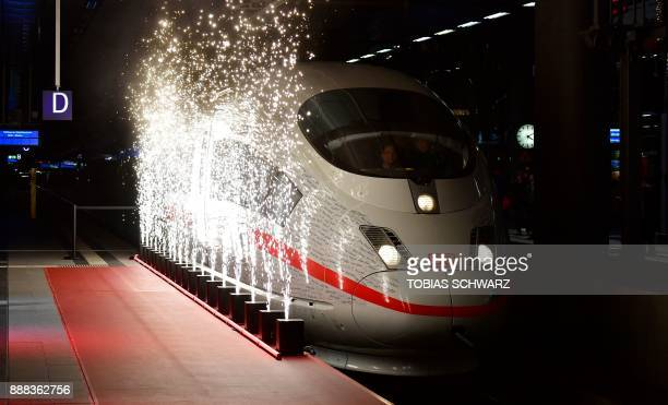 Fireworks light upon arrival of a special ICE high speed train at the railway station in Berlin as the train inaugurates a new fast route between...