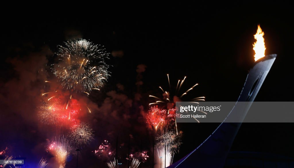 Fireworks on display behind he Olympic Cauldron in the Olympic Park during the Opening Ceremony of the Sochi 2014 Winter Olympics at Fisht Olympic Stadium on February 7, 2014 in Sochi, Russia.