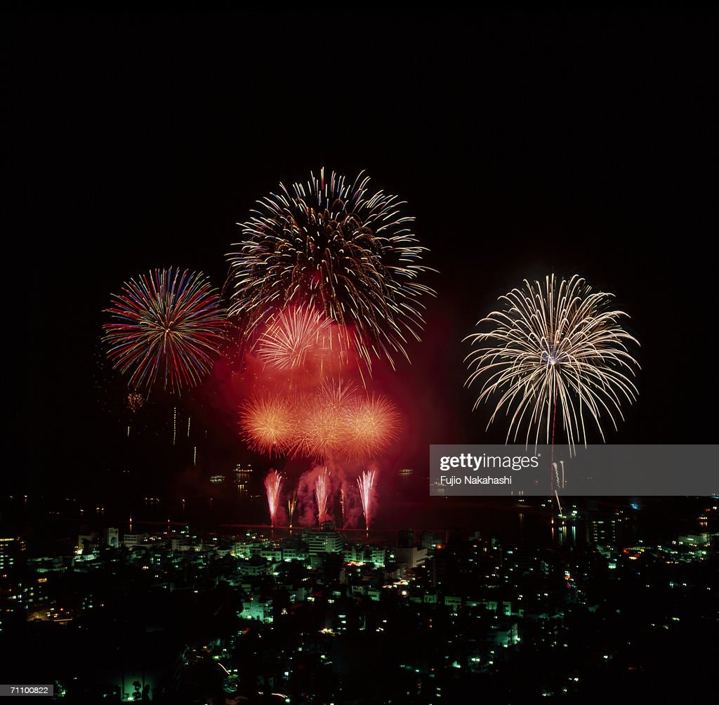 Fireworks over city at night, high angle view : Stock Photo