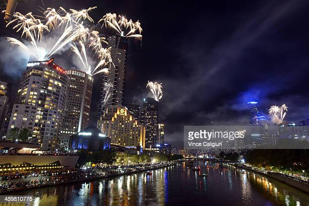 Fireworks over Melbourne skyline and Yarra River during New Years Eve fireworks on December 31 2013 in Melbourne Australia