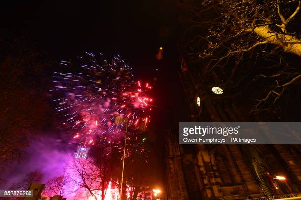 Fireworks over the church of St Thomas the martyr at the New Year's eve Winter Carnival in Newcastle city centre
