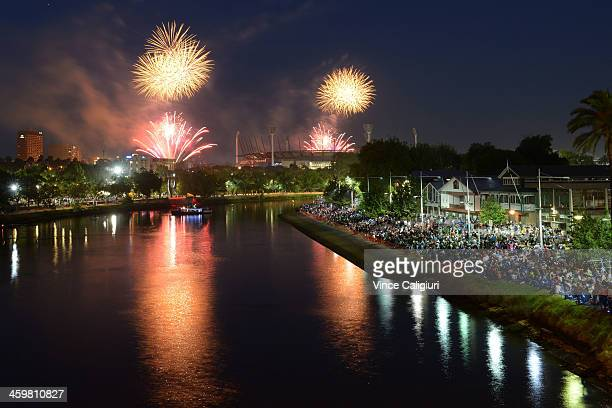 930PM fireworks over The Melbourne Cricket Ground and Yarra River during New Years Eve fireworks on December 31 2013 in Melbourne Australia