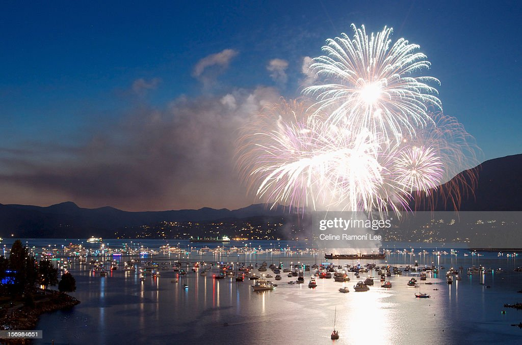 Fireworks over the water and boats : Stock Photo