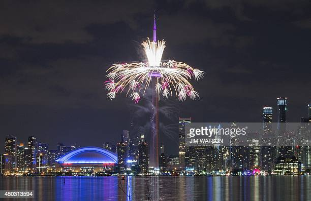 Fireworks shoot off from the CN Tower during the opening ceremony for the 2015 Pan American Games in Toronto Ontario July 10 2015 AFP PHOTO/ JIM...