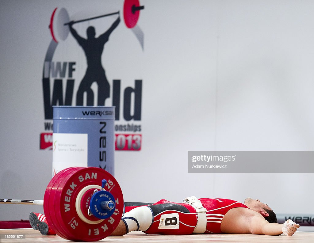 Firidun Guliyev from Azerbaijan lies on the floor after his new youth world record in the Clean & Jerk competition in men's 69 kg Group A during weightlifting IWF World Championships Wroclaw 2013 at Centennial Hall in Wroclaw on October 23, 2013
