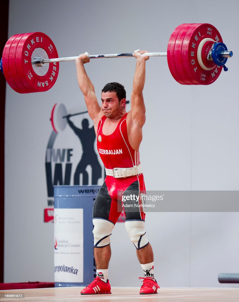 Firidun Guliyev from Azerbaijan lifts in the Clean & Jerk competition in men's 69 kg Group A during weightlifting IWF World Championships Wroclaw 2013 at Centennial Hall in Wroclaw on October 23, 2013
