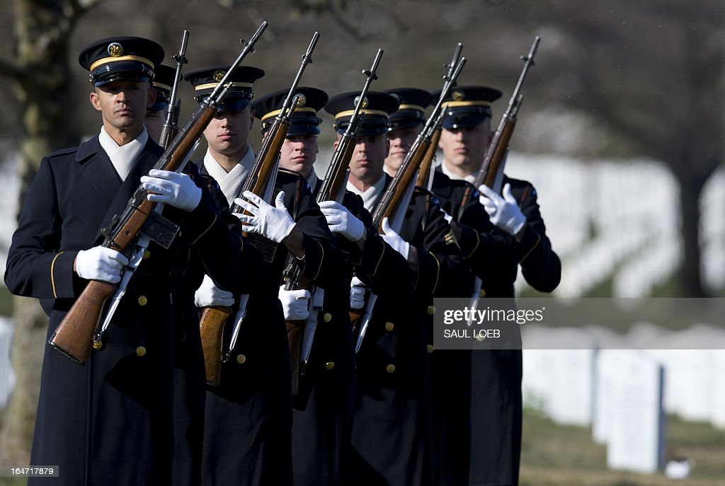 A firing party from the US Army's 3rd Infantry Regiment 'The Old Guard' prepares to fire three rifle volleys during a burial service for US Army Captain Andrew Pedersen-Keel in Section 60 at Arlington National Cemetery in Arlington, Virginia, March 27, 2013. Pedersen-Keel, 28, was killed March 11 during an attack on a police station in Afghanistan. AFP PHOTO / Saul LOEB