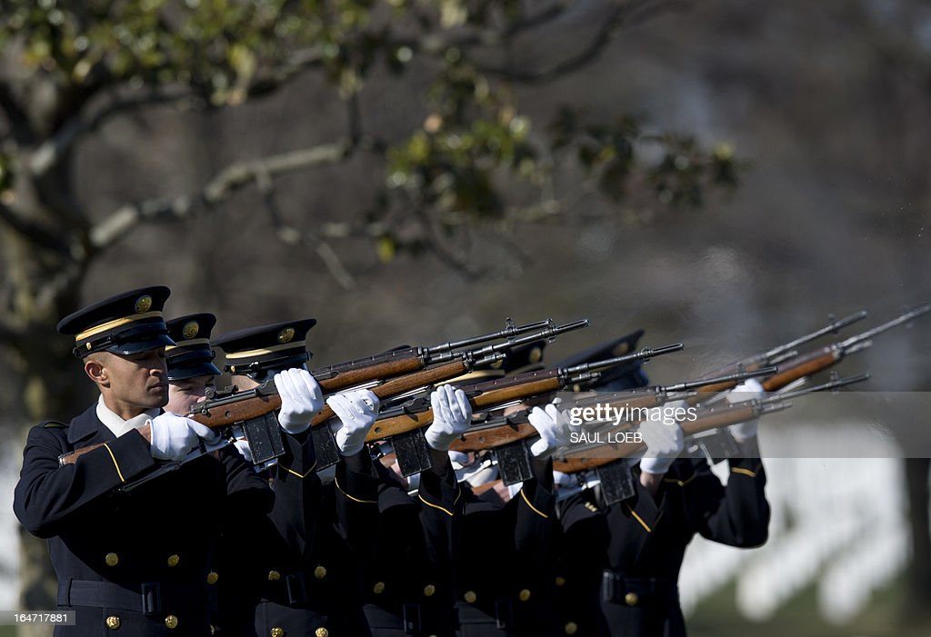 A firing party from the US Army's 3rd Infantry Regiment 'The Old Guard' fires three rifle volleys during a burial service for US Army Captain Andrew Pedersen-Keel in Section 60 at Arlington National Cemetery in Arlington, Virginia, March 27, 2013. Pedersen-Keel, 28, was killed March 11 during an attack on a police station in Afghanistan. AFP PHOTO / Saul LOEB